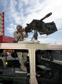 A soldier stands guard in front of the Camino Real Hotel in Ciudad Juarez, Mexico.